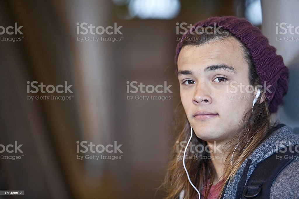 Teenage boy listening to music stock photo
