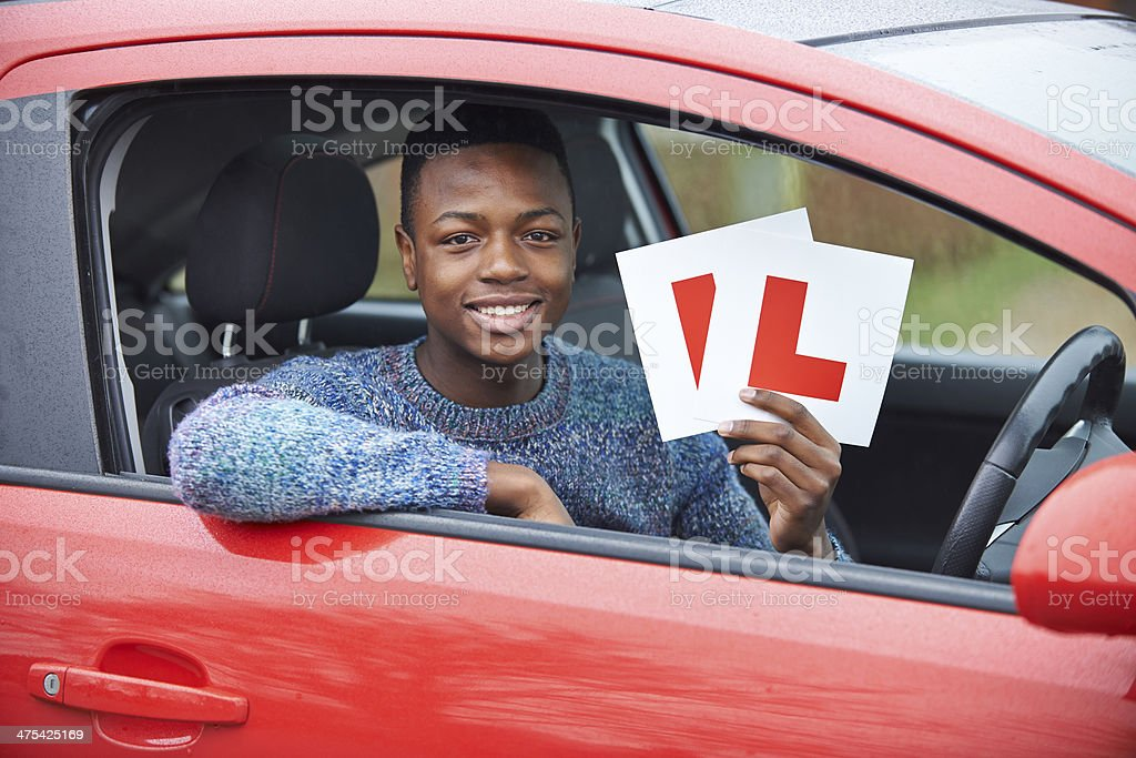 Teenage Boy Passing Driving Exam stock photo