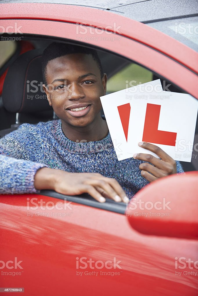 Teenage Boy Passing Driving Test stock photo