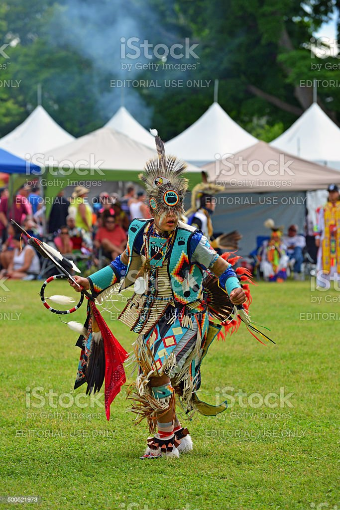 Teenage boy performs traditional native dance stock photo