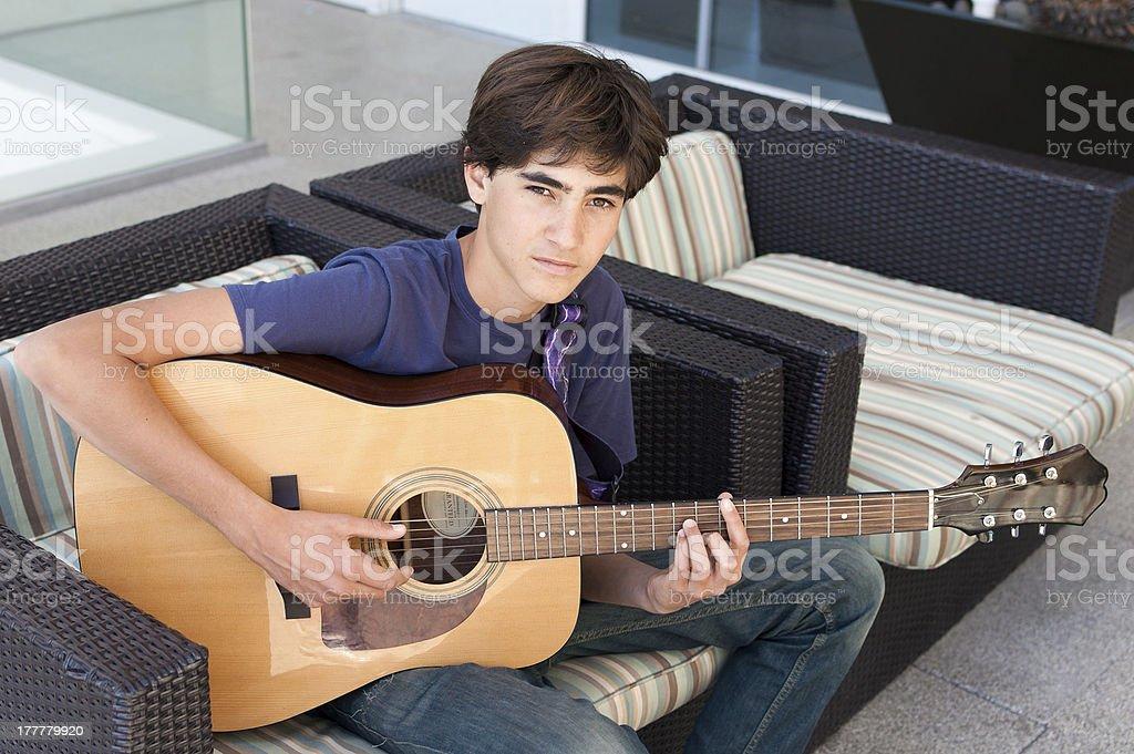 Teenage Boy playing Acoustic Guitar royalty-free stock photo