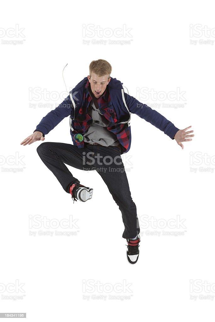 Teenage boy playing hacky sack stock photo