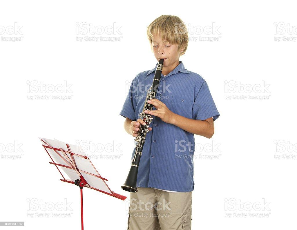 Teenage Boy Playing the Clarinet royalty-free stock photo