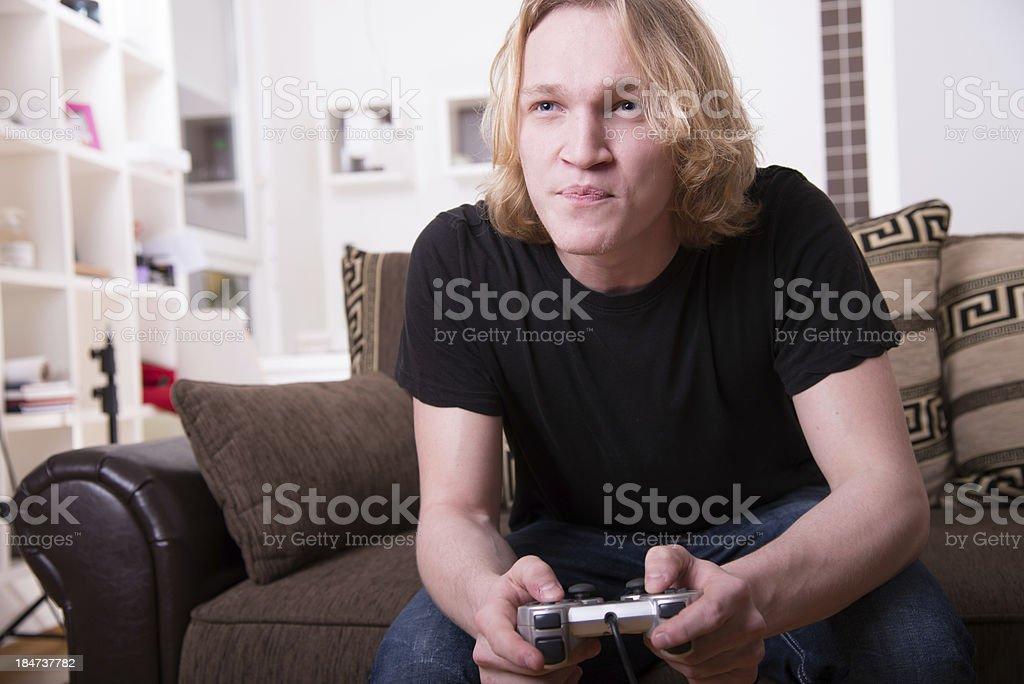 Teenage boy playing video games royalty-free stock photo