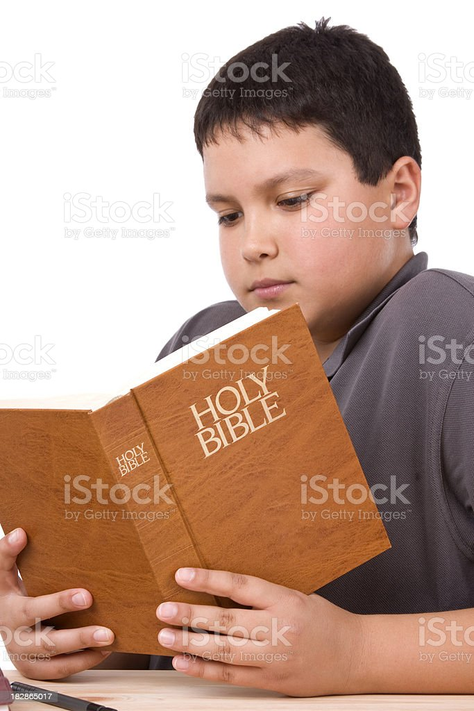 Teenage boy reading bible royalty-free stock photo