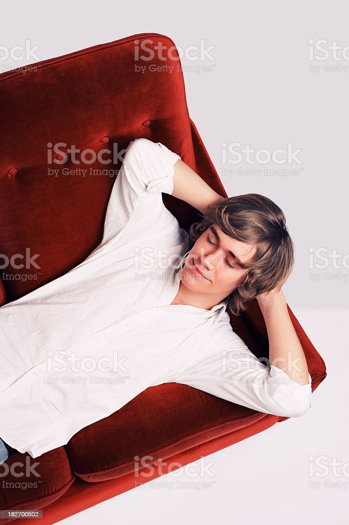 Teenage boy relaxing on a couch royalty-free stock photo