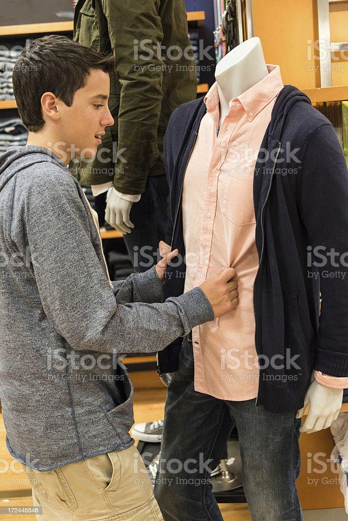 Teenage boy shopping royalty-free stock photo