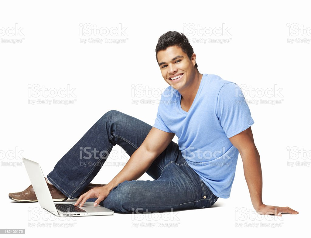 Teenage Boy Sitting With a Laptop royalty-free stock photo