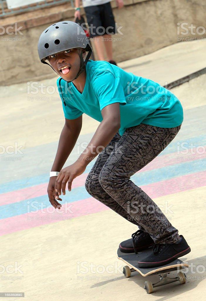 Teenage boy skateboarding on his skateboard royalty-free stock photo