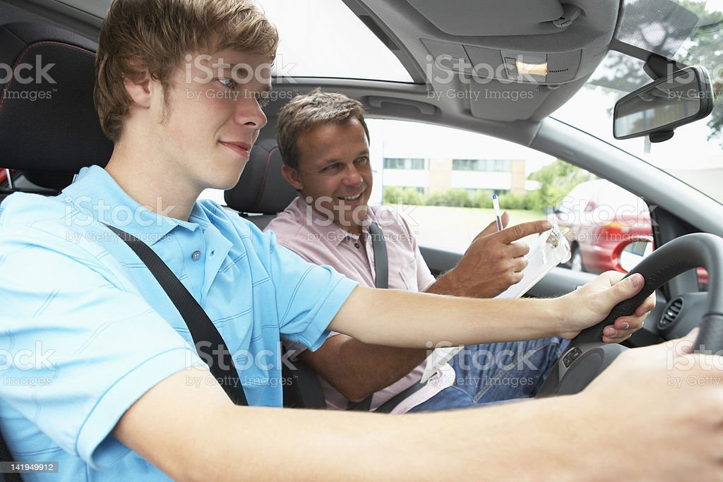 Teenage Boy Taking A Driving Lesson stock photo