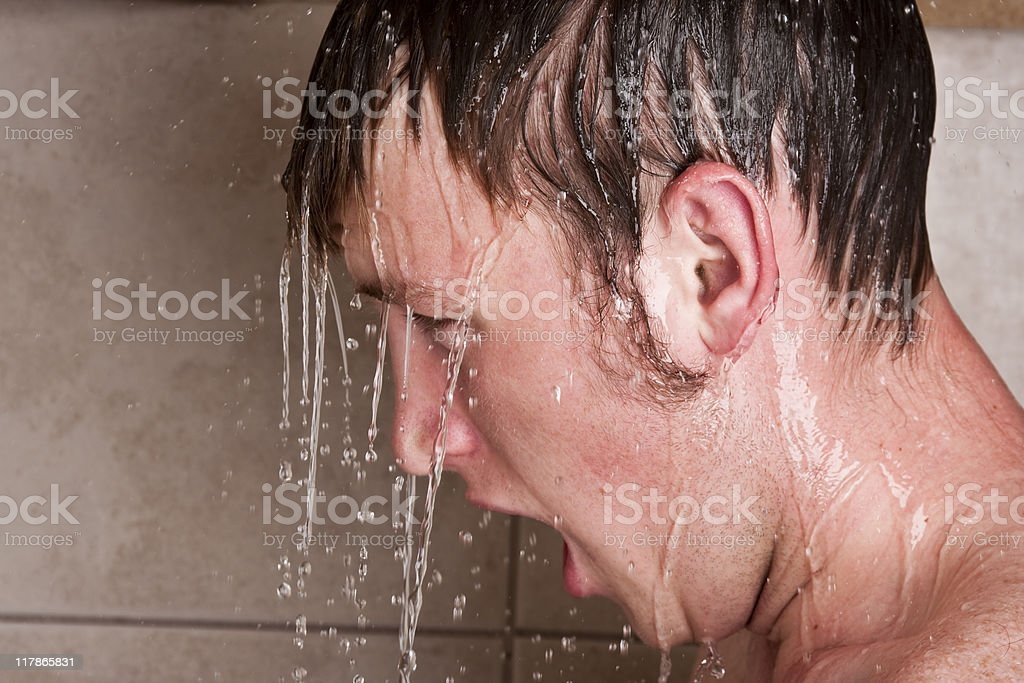 Teenage boy taking a shower royalty-free stock photo