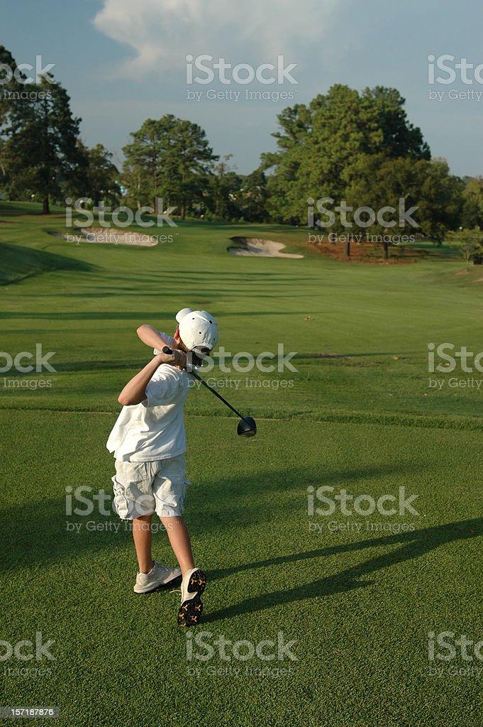Teenage Boy Teeing Off stock photo