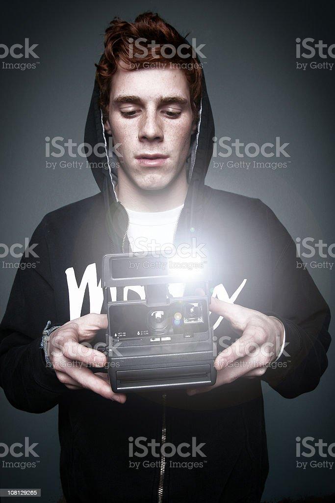 Teenage Boy Using Camera royalty-free stock photo