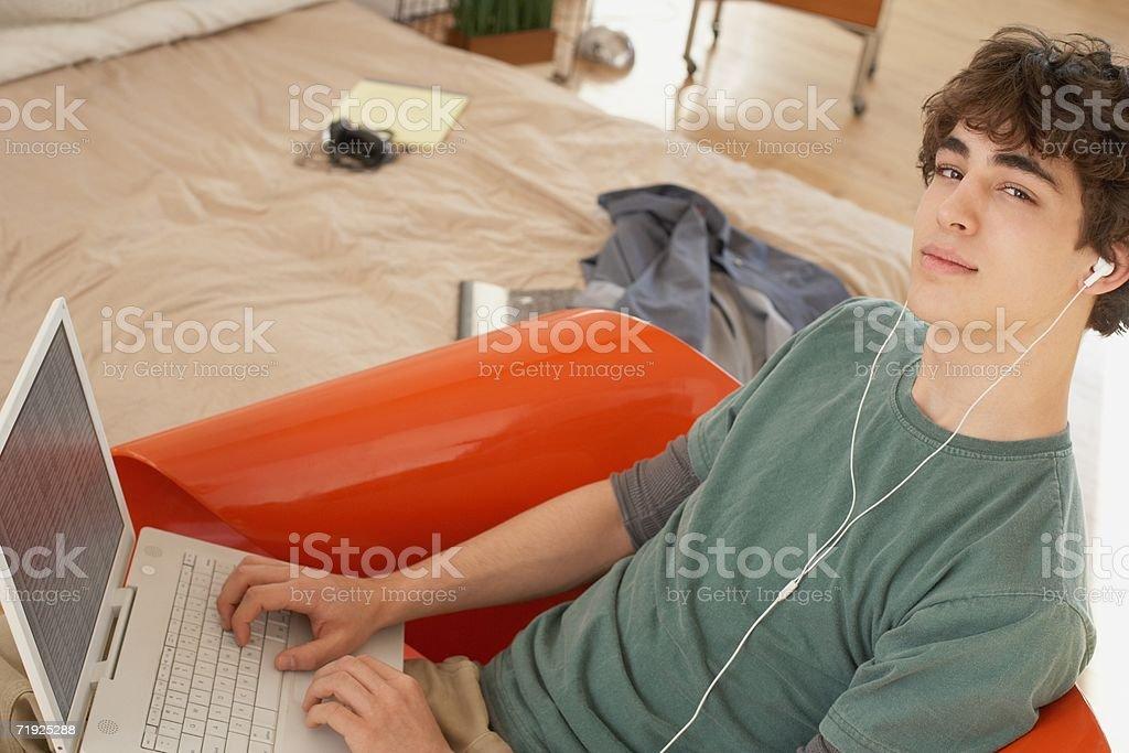Teenage boy using laptop stock photo