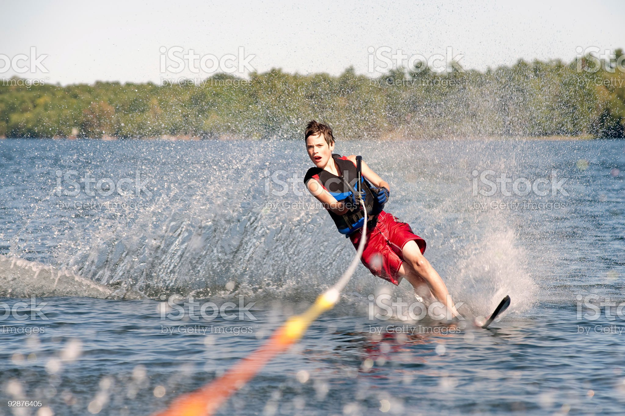 Teenage boy waterskiing on a lake royalty-free stock photo