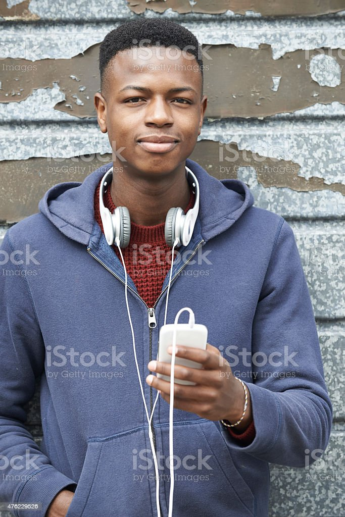 Teenage Boy Wearing Headphones And Listening To Music stock photo