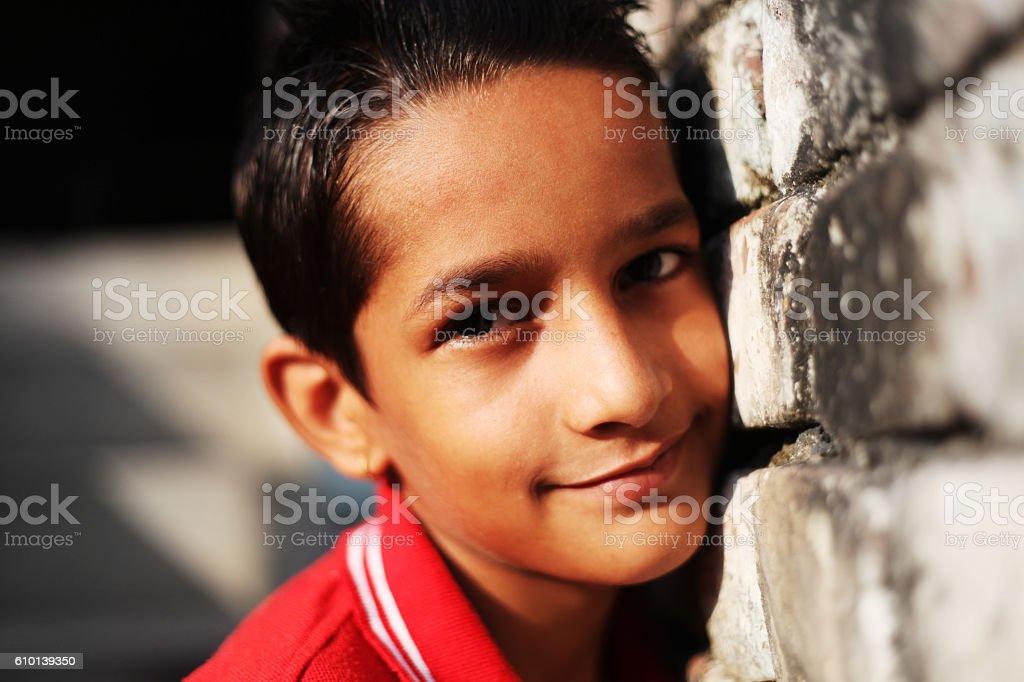 Teenage Boy With Brick Wall stock photo