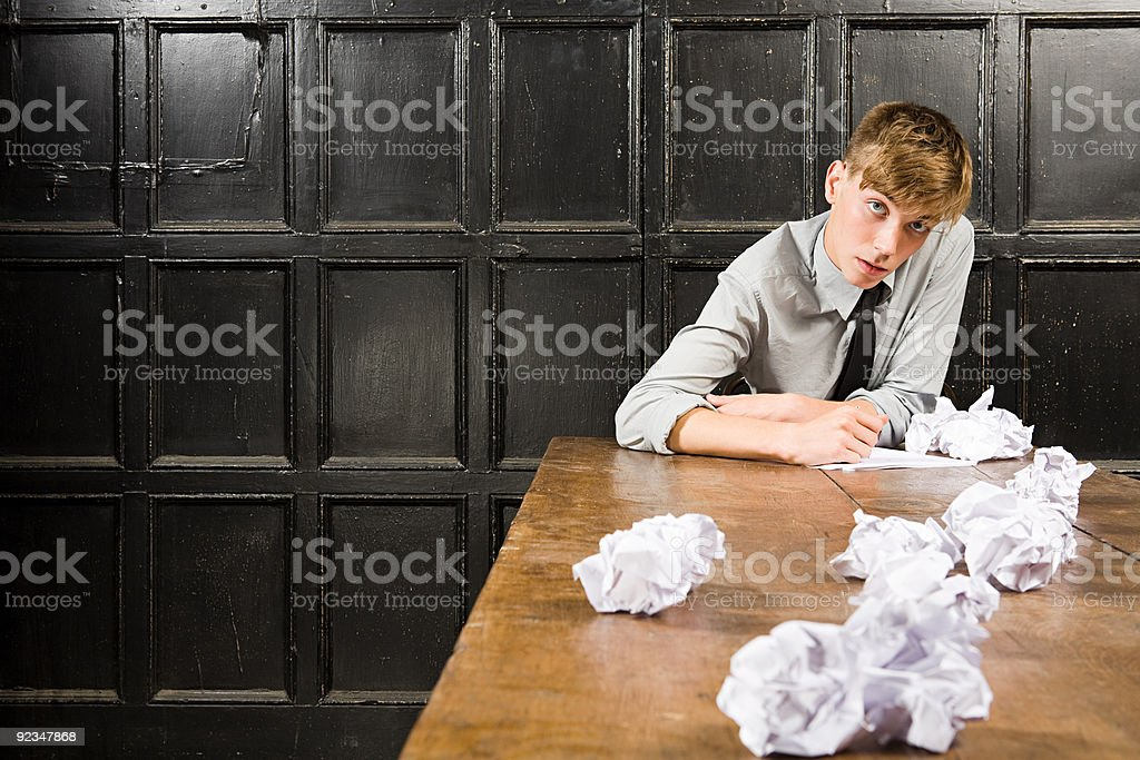Teenage boy with crumpled paper royalty-free stock photo