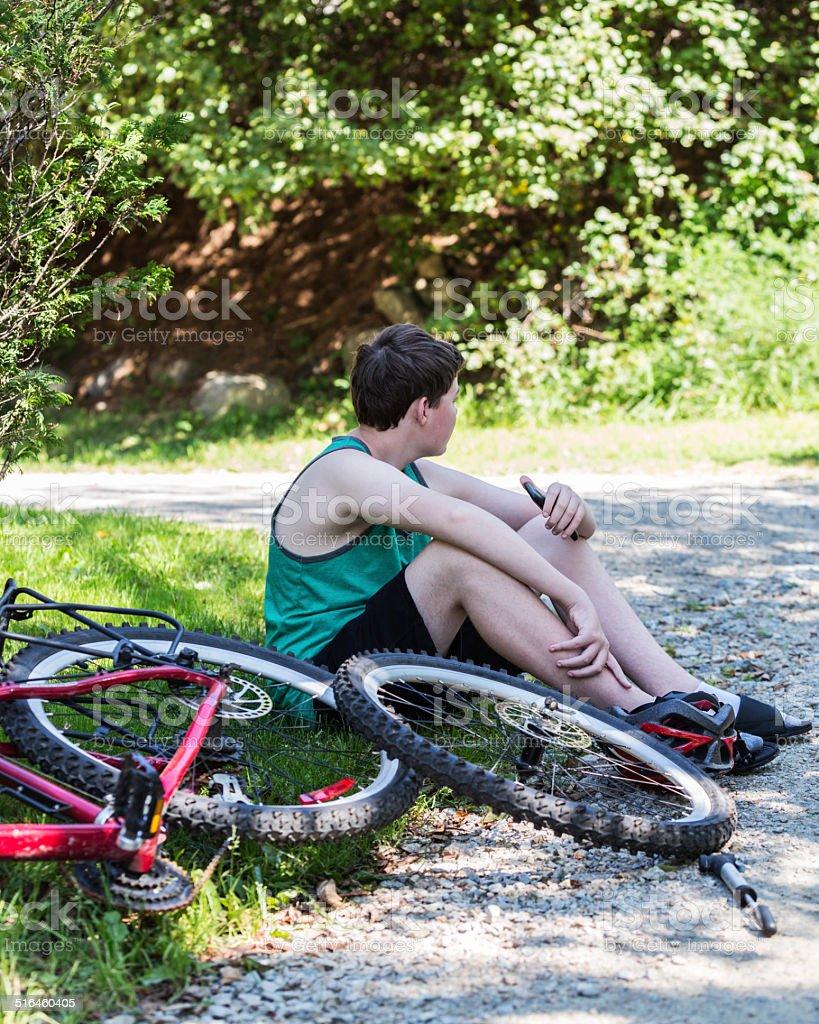 Teenage Boy With Flat Bicycle Tire stock photo