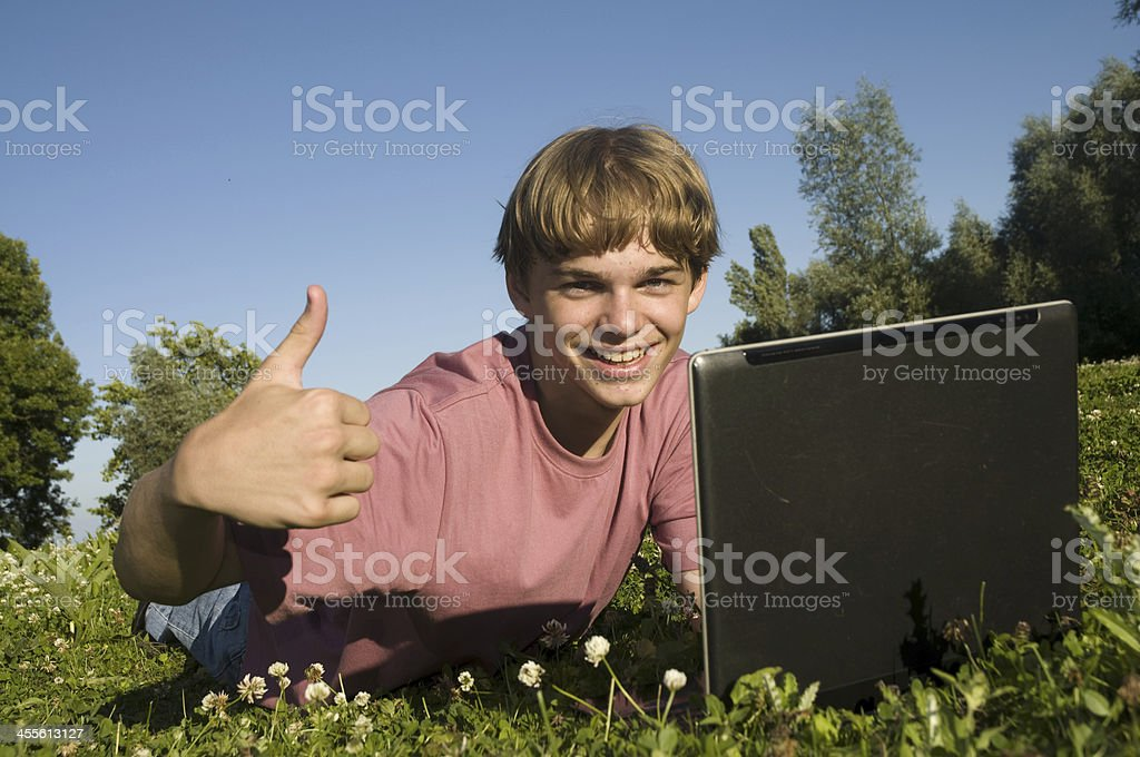 teenage boy with laptop royalty-free stock photo