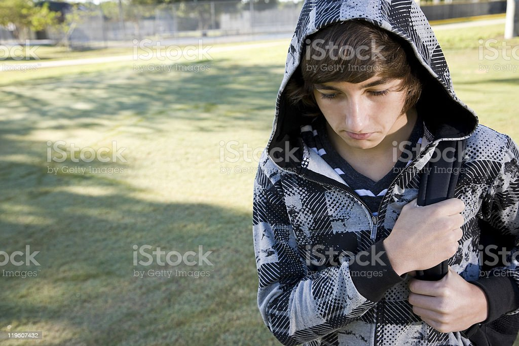 Teenage boy with school backpack stock photo