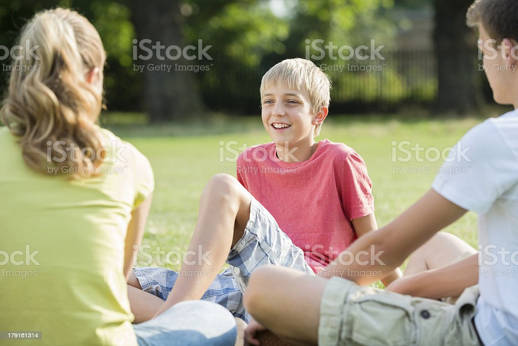 Teenage Boy With Siblings In Park royalty-free stock photo