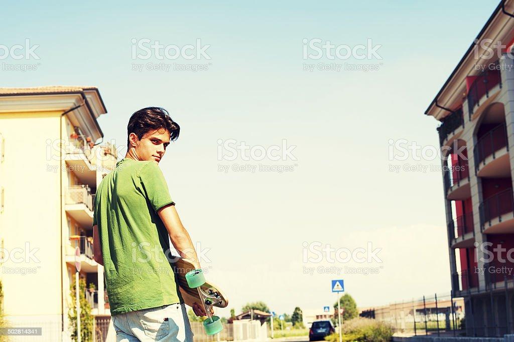Teenage boy with skateboard royalty-free stock photo