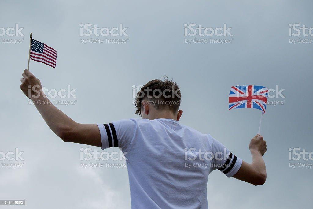Teenage boy with United States and Union Jack Flag stock photo