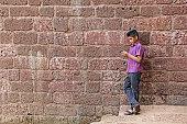 Teenage Boy Working on Smartphone