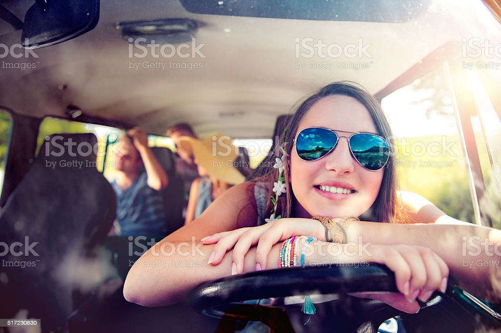 Teenage boys and girls inside an old campervan, roadtrip stock photo