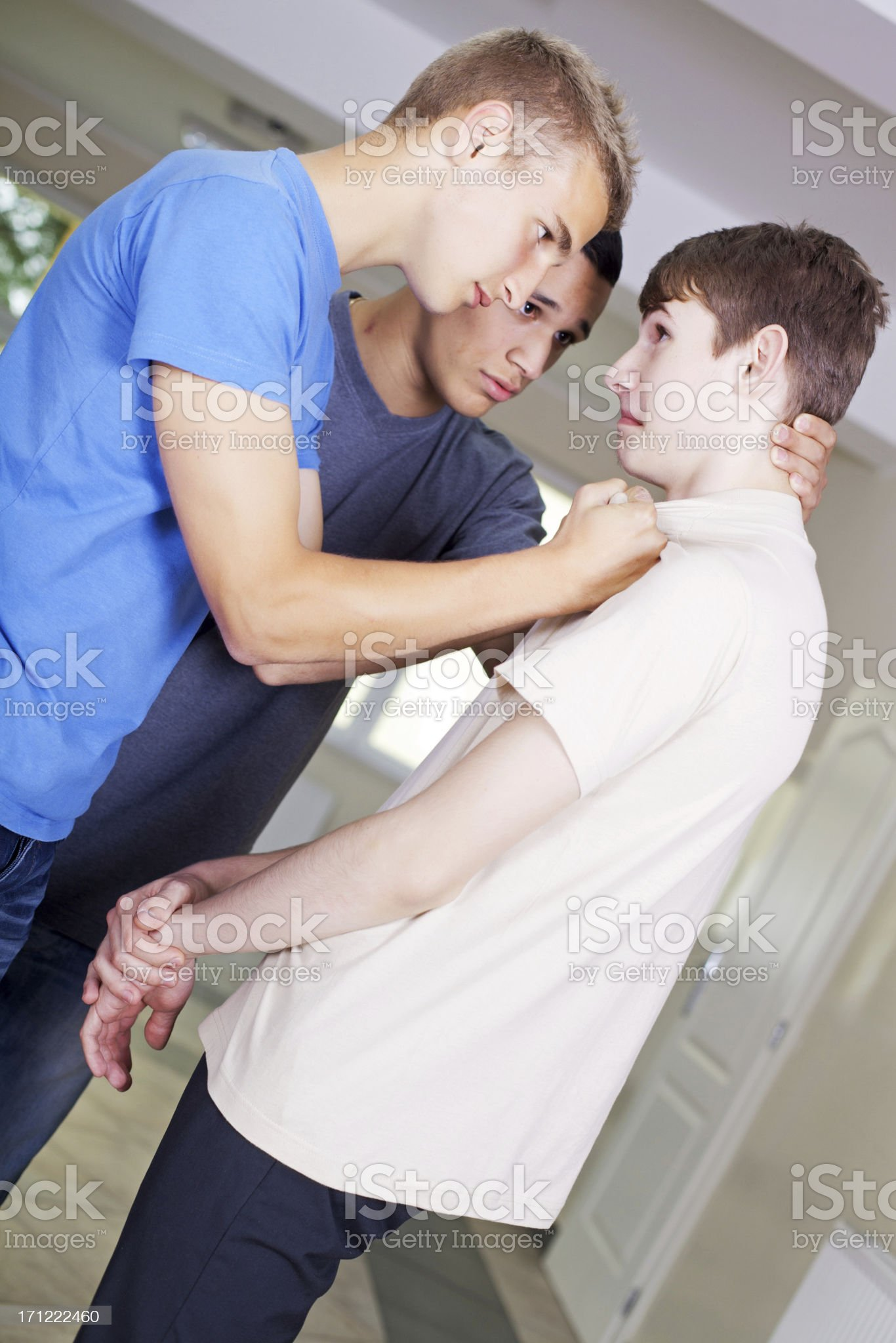 Teenage boys bullying their classmate. royalty-free stock photo