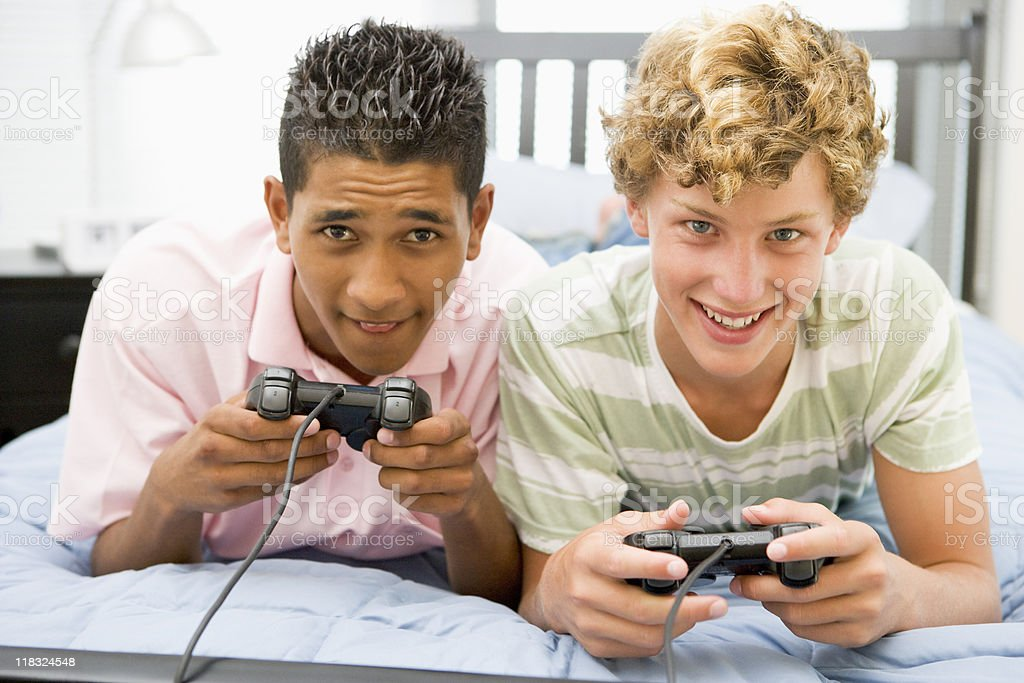 Teenage Boys Playing Video Games royalty-free stock photo