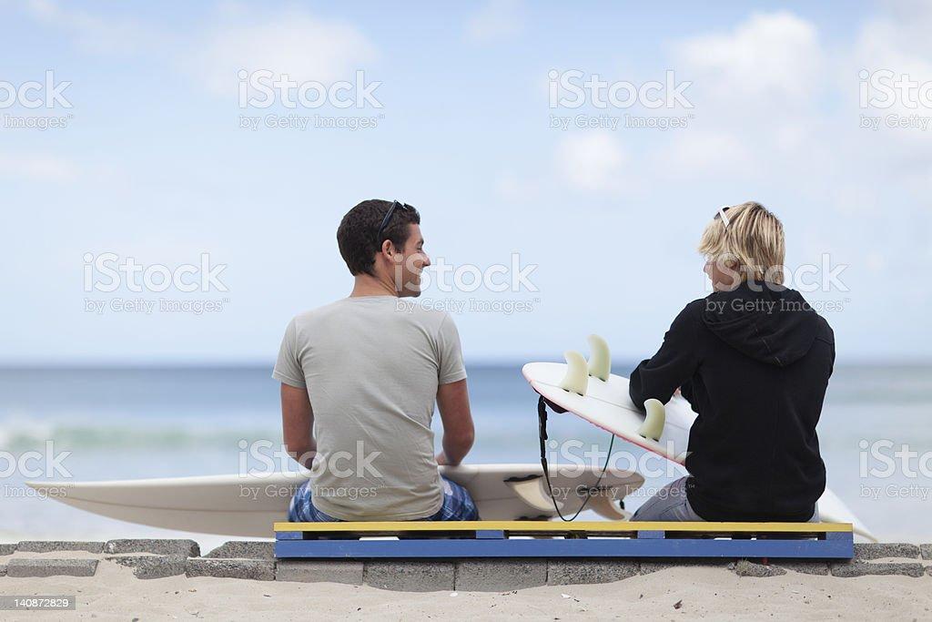 Teenage boys with surfboards on beach stock photo