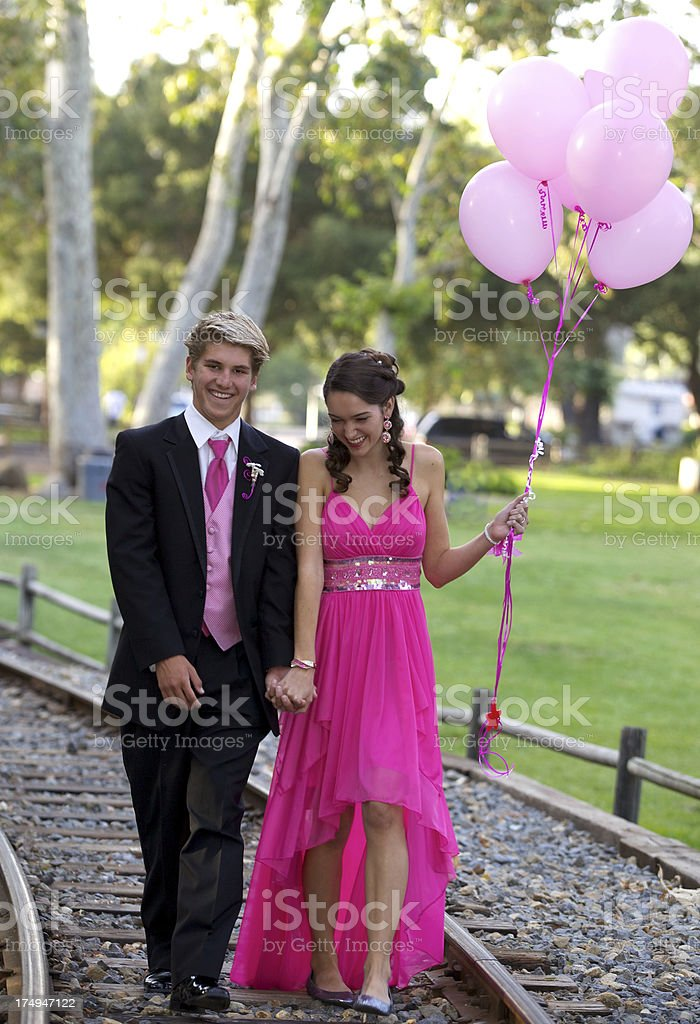 Teenage Couple at Park Before Prom with Balloons royalty-free stock photo