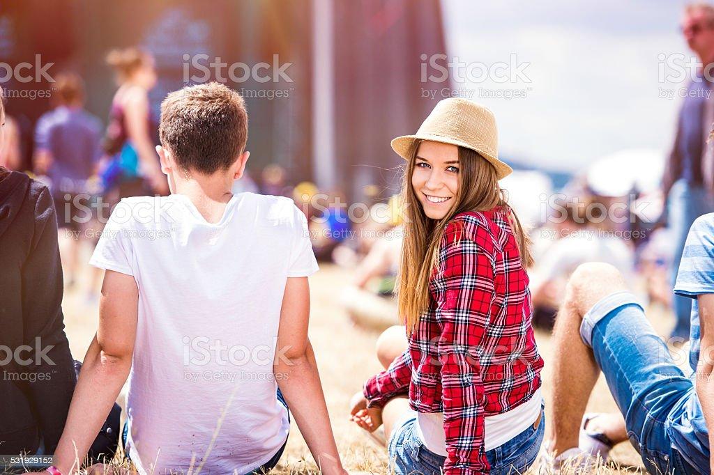 Teenage couple at summer music festival stock photo