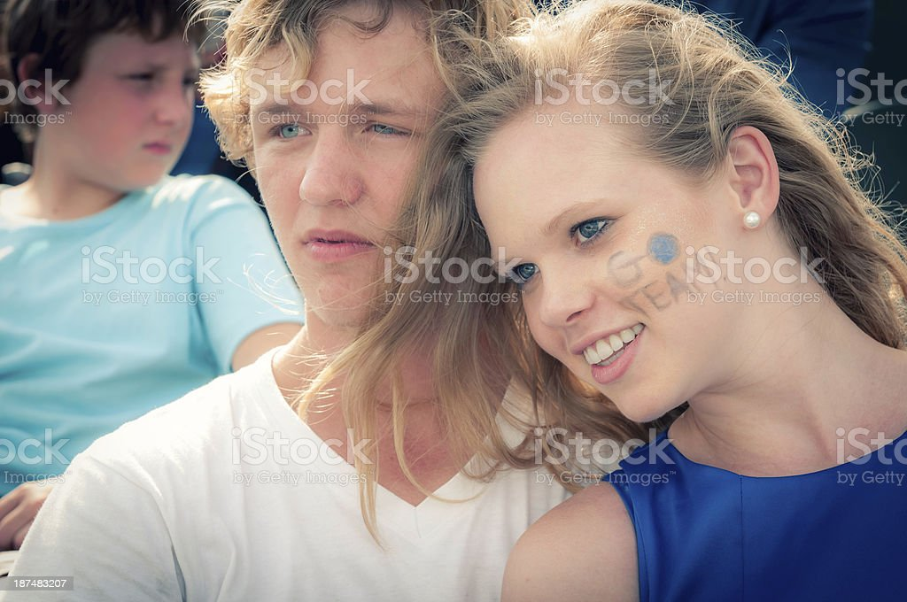 Teenage couple at the football game - III royalty-free stock photo