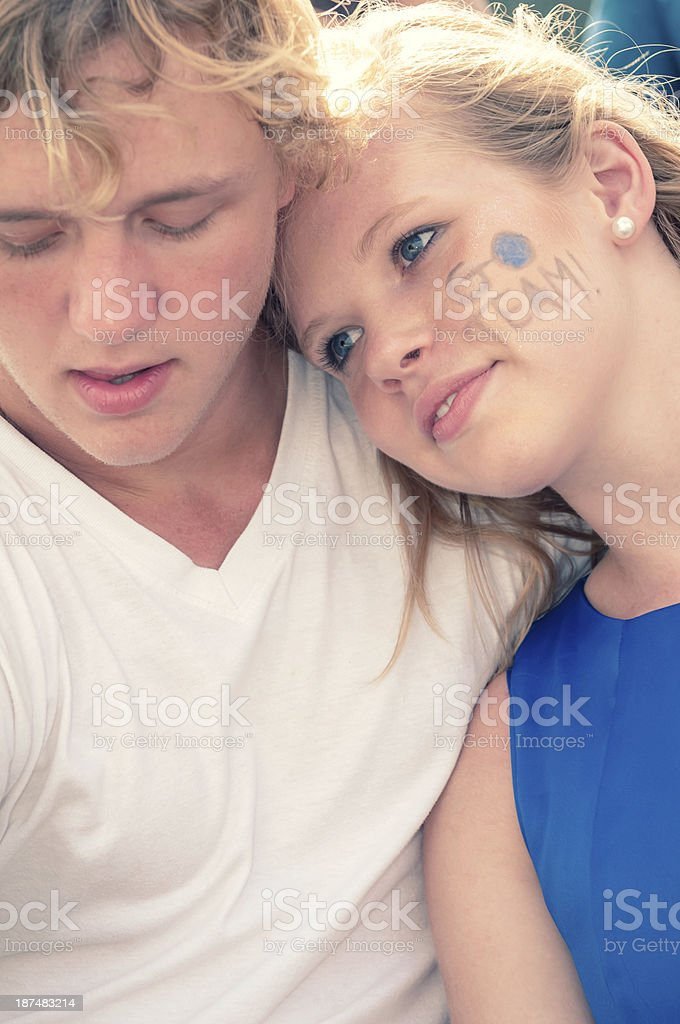 Teenage couple at the football game - IV royalty-free stock photo