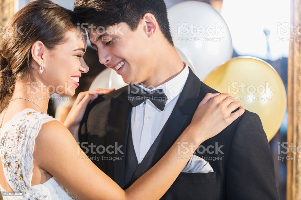 Teenage couple dancing at prom stock photo