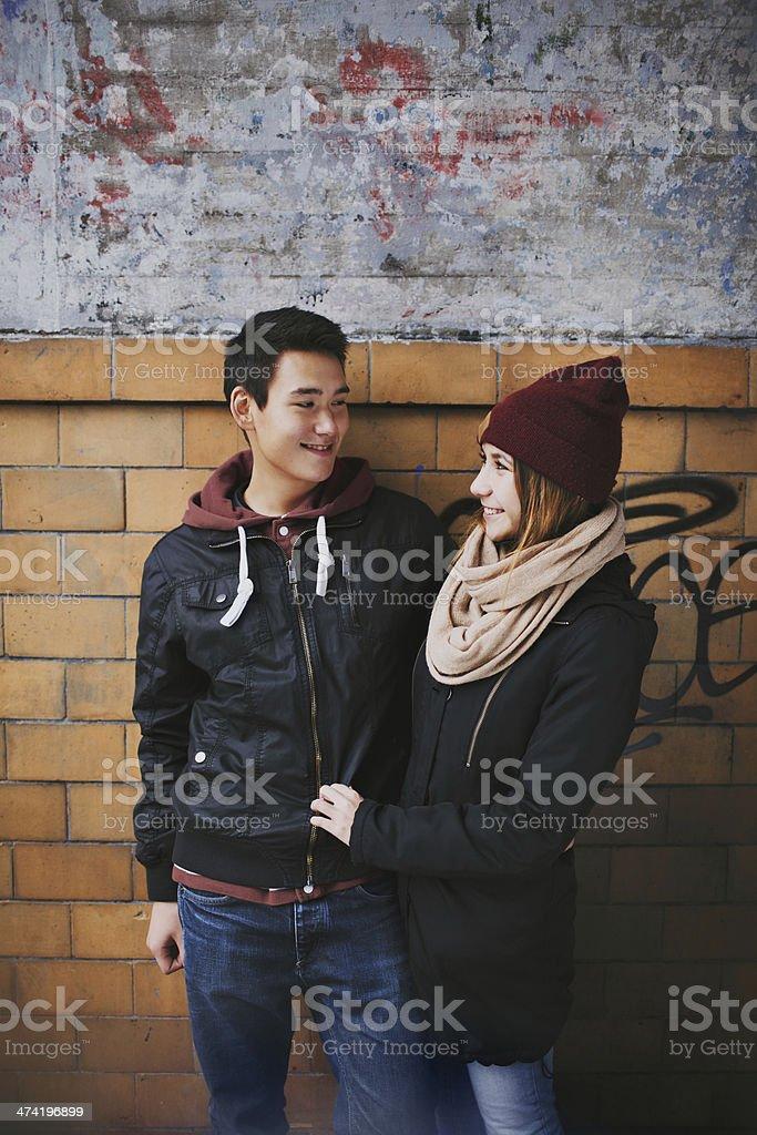 Teenage couple enjoying each others company stock photo