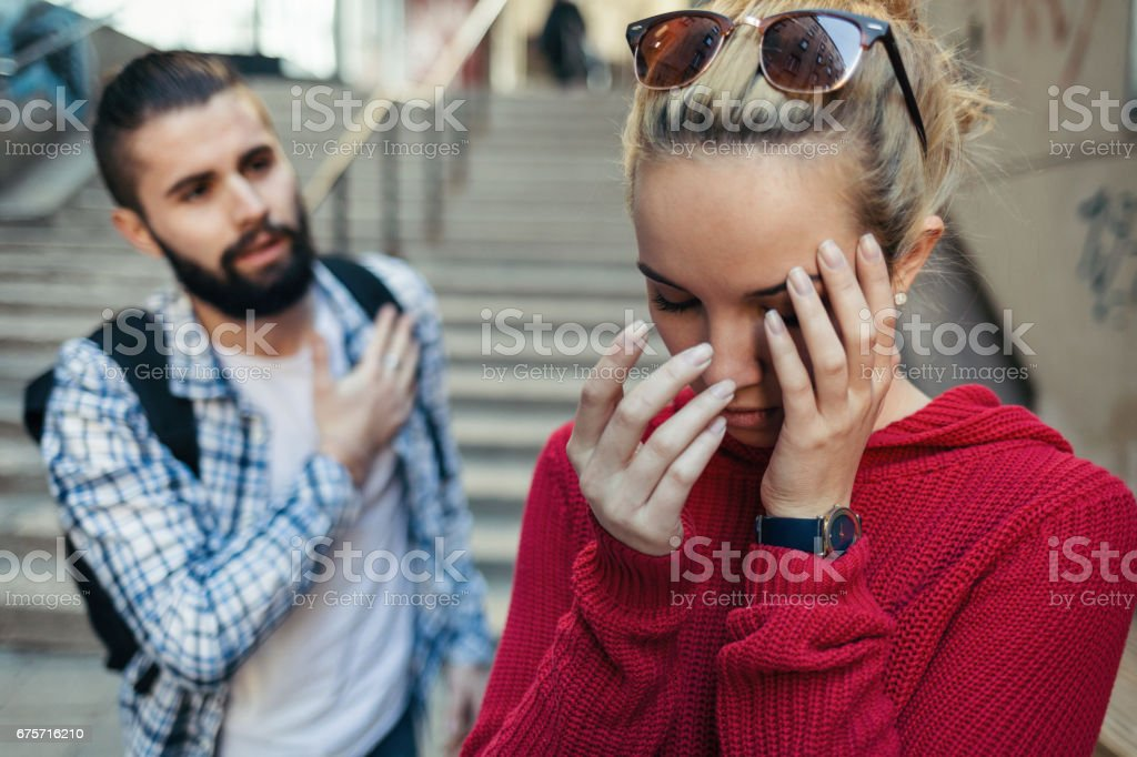 Teenage couple having a dispute on the stairs stock photo