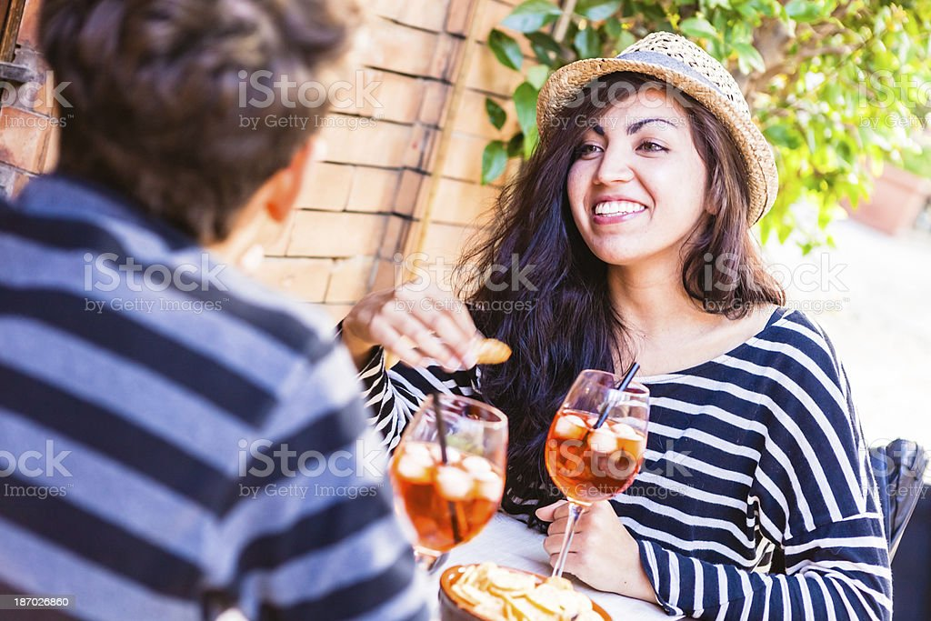 Teenage Couple Having Fun at the Outdoors Cafe royalty-free stock photo