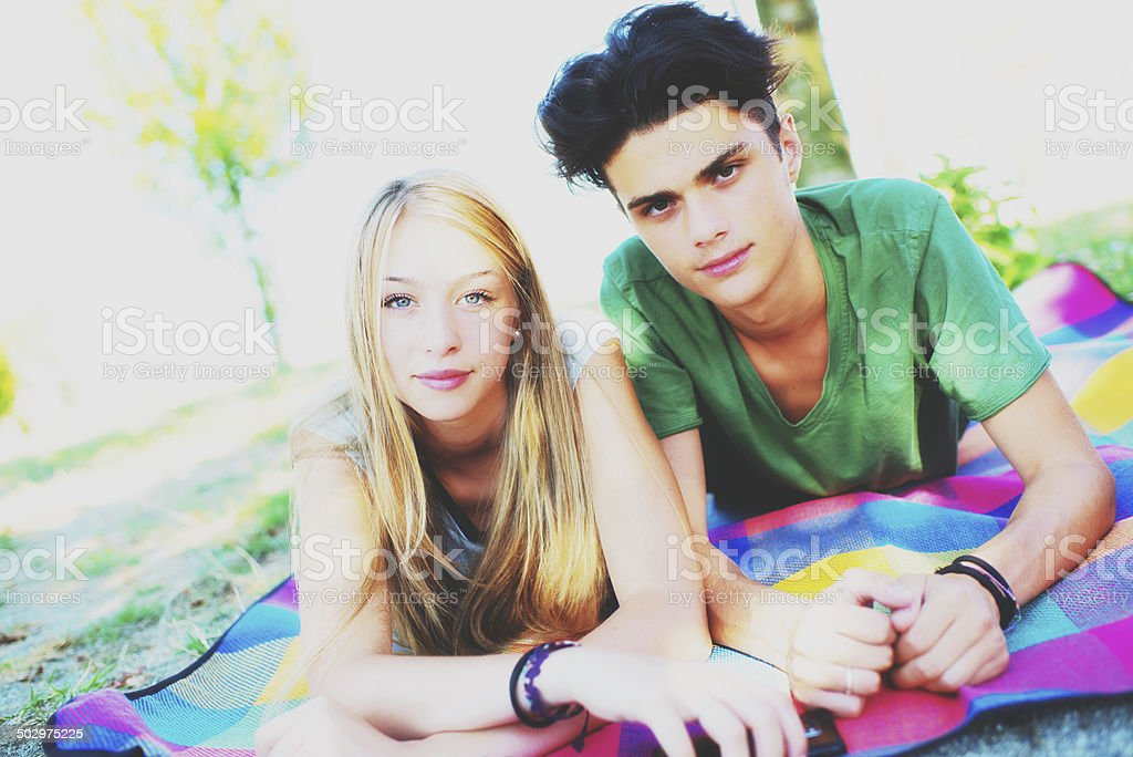 Teenage couple lying on the plaid stock photo