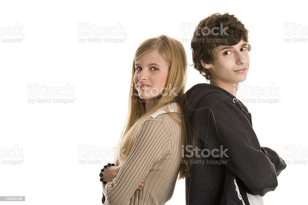 Teenage couple standing with arms crossed stock photo