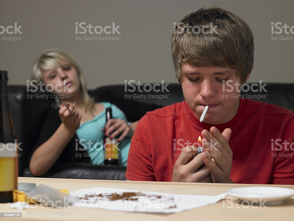 Teenage Couple Taking Drugs At Home stock photo