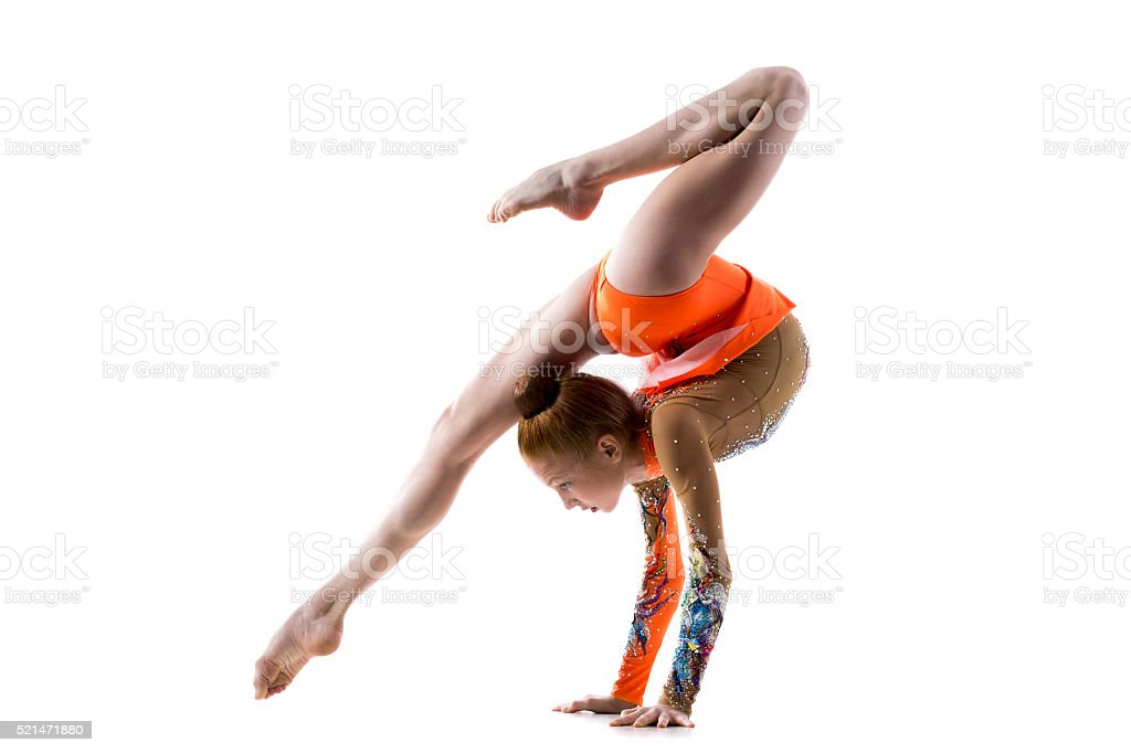 Teenage dancer girl doing handstand stock photo
