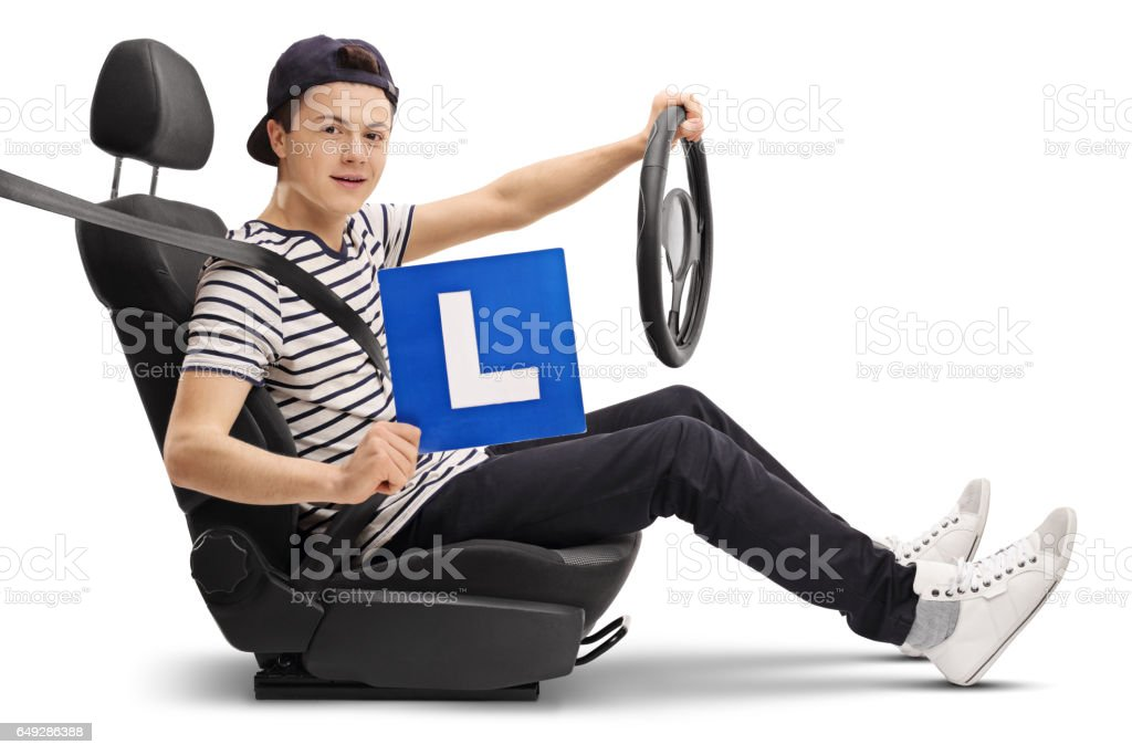 Teenage driver in a car seat showing an L-sign stock photo