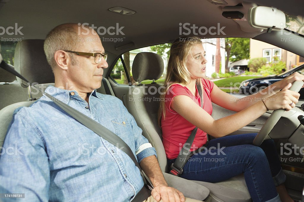 Teenage Driver Learning to Drive with Parent or Driving Instructor royalty-free stock photo