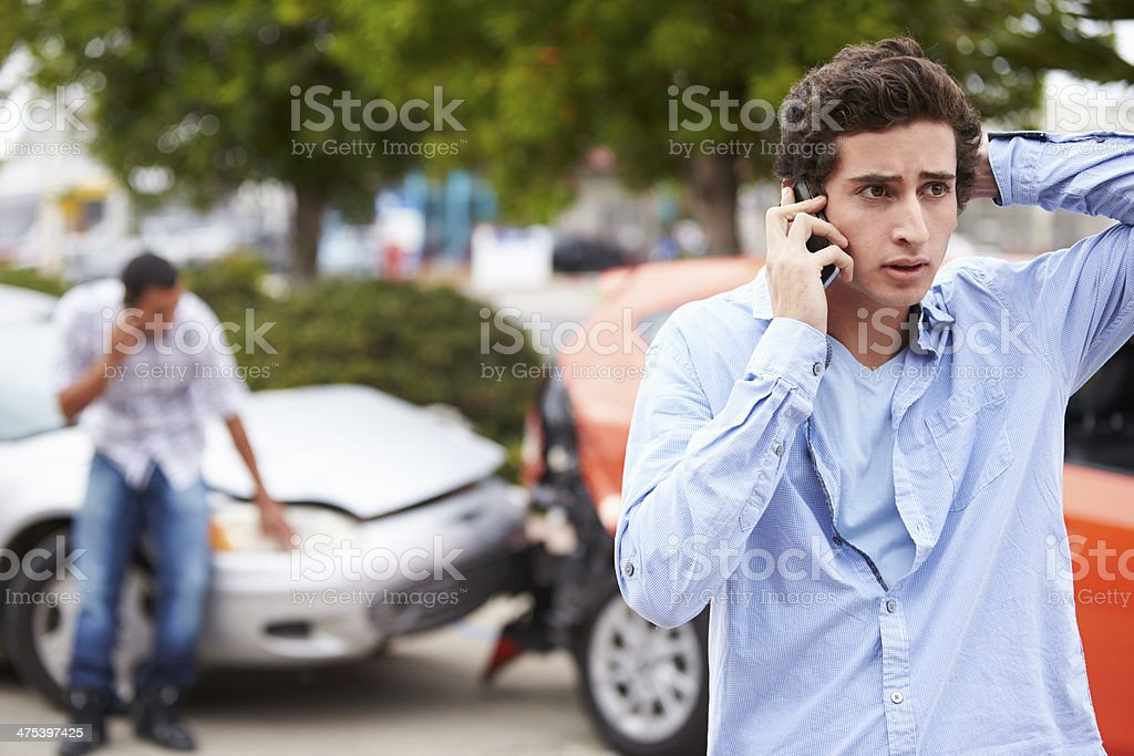 Teenage Driver Making Phone Call After Traffic Accident stock photo