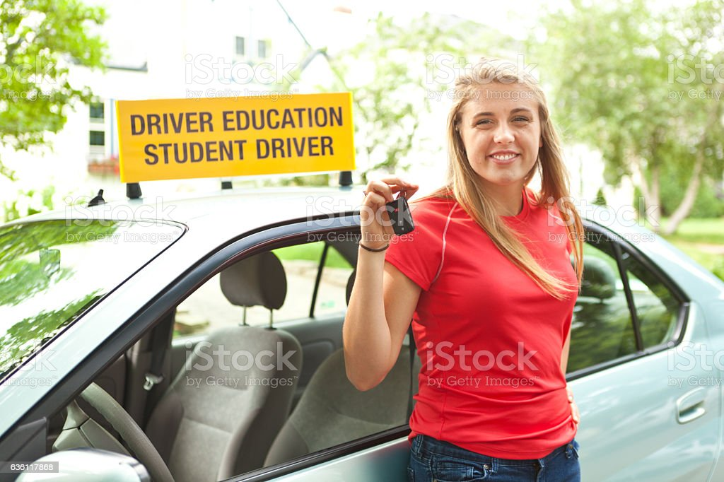 Teenage Driver Receive Key to Her First Car stock photo