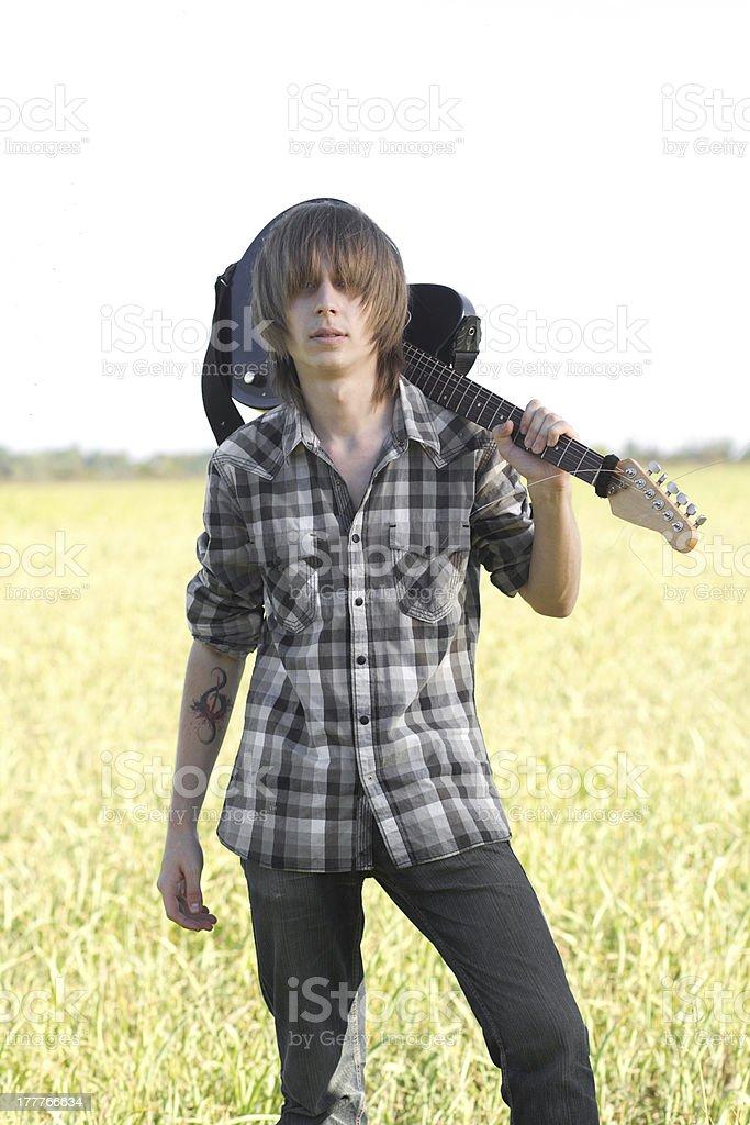Teenage emo guitarist stock photo